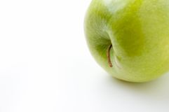 Apple on side. Green apple on white stock images