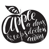 Apple silhouette with lettering. Royalty Free Stock Image
