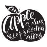 Apple siluetea con las letras Imagen de archivo libre de regalías