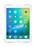 Apple Silver iPad Air 2 with iOS 9, designed by Apple Inc. Front view of Apple Silver iPad Air 2 with touch ID displaying announced on WWDC 2015 iOS 9 operating stock image