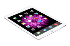Apple Silver iPad Air 2 with iOS 8 lies on the surface, designed stock photo