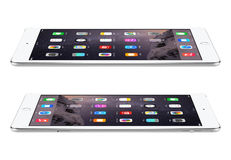 Apple Silver iPad Air 2 with iOS 8 lies on the surface, designed Stock Images