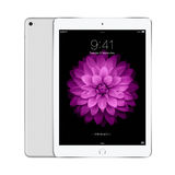 Apple Silver iPad Air 2 with iOS 8 with lock screen on the displ Royalty Free Stock Photography