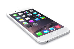 Apple Silver iPhone 6. Plus showing the home screen with iOS 8.The new iPhone with higher-resolution 4.7 and 5.5-inch screens, improved cameras, new sensors, a Stock Photo