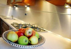 Apple in silver kitchen. Apple in silver and brown kitchen Stock Photos