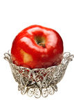 Apple in a silver openwork vase Royalty Free Stock Photo