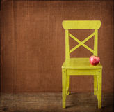 Apple sitting on classroom chair Stock Photography