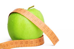 Apple size sliming. The green juicy apple for a diet personifies health and sports Stock Photos