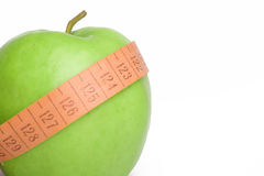 Apple size sliming. The green juicy apple for a diet personifies health and sports Stock Photo