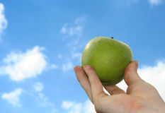 Apple and sky Stock Image