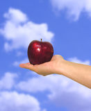 Apple in Sky Stock Photography