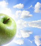 Apple and sky Royalty Free Stock Photos
