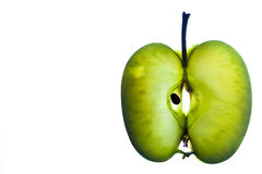 Apple slice. Back lit against a white back ground Royalty Free Stock Images