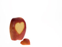 Apple slice with heart symbol. Isolated on white stock images