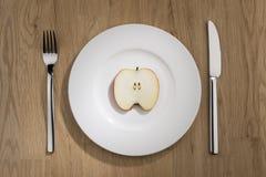 Apple slice on plate Stock Photo