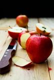 Apple sliced and peel. Sweet delicious apple sliced and peel on wooden table, selective focus Stock Images