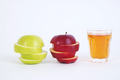 Apple sliced sections and apple juice. Red and green apple on white background Royalty Free Stock Images