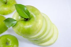 Apple sliced in thin pieces Stock Photos