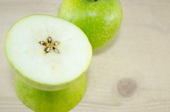 Apple sliced in thin pieces Stock Images