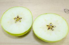 Apple sliced in thin pieces Stock Photo