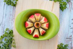 Free Apple Slicer With Red Apple Cutted Into Eight Pieces On Cutting Board Stock Photo - 188280870