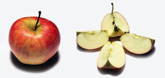 Apple and slices. Apple and four slices of the apple Stock Image