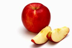 Apple and slices. A braeburn apple and two slices on a white background stock photo