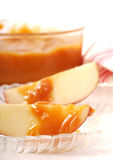 Apple slices with caramel royalty free stock photography