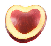 Apple slices. Heart shaped apple slices on a white background Stock Photography