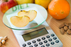 Apple slices on kitchen scale Stock Images