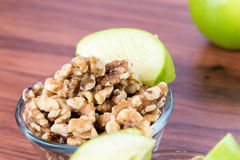 Apple slices and nuts. Healthy snack: apple slices and nuts royalty free stock image