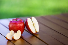 Apple and slices on table Royalty Free Stock Photo