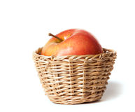Apple in a small basket Stock Image