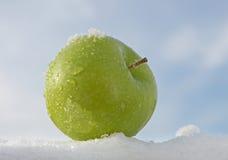 Apple on snow. Green Apple isolated on white Stock Photos