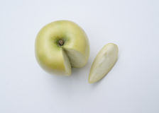 Apple. SONY DSC Incised green Apple and a slice of Apple on a blue background,variety: Semerenko Royalty Free Stock Image