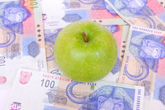 Apple on South African rands Royalty Free Stock Photography