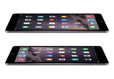 Apple Space Gray iPad Air 2 with iOS 8 lies on the surface, desi Royalty Free Stock Photos
