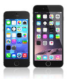 Apple Space Gray iPhone 6 and iPhone 5s. Showing the home screen with iOS 8 and ios 7.The new iPhone with higher-resolution 4.7 improved cameras, new sensors, a Stock Image