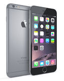 Apple Space Gray iPhone 6 Plus. Showing the home screen with iOS 8.The new iPhone with higher-resolution 4.7 and 5.5-inch screens, improved cameras, new sensors Royalty Free Stock Photography