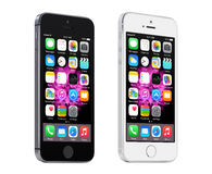 Apple Space Gray and Silver iPhone 5S displaying iOS 8, designed Royalty Free Stock Images