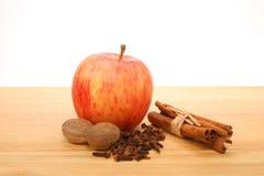 Apple and spice. S,cinnamon,nutmeg and cloves Stock Photos