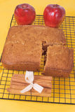 Apple Spice Bread. Homemade apple spice bread cooling on a kitchen rack with red delicious apples and cinnamon sticks Stock Photography