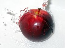 Apple with a splash. Red apple splashed with water Royalty Free Stock Images