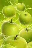 Apple splash. Green apple fruits and splashing water royalty free stock photography