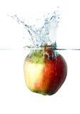 Apple splash in water Stock Images