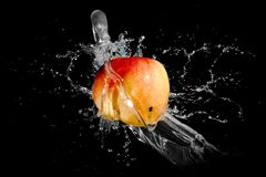 On Apple splash water Royalty Free Stock Image