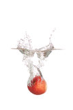 Apple splash into water. Apple splash into the water.. showing freshness and healthy of fruit Stock Photography