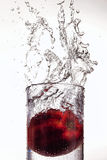 Apple Splashing In Glass Of Water Stock Photos