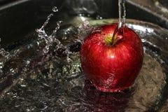 Apple splashing Royalty Free Stock Image