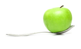 Apple and spoon Stock Image